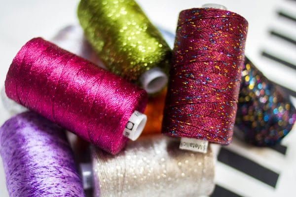 Add a new element to your projects with Dazzle™ 8wt rayon and metallic threads, available in a variety of designer colour collections and our own.