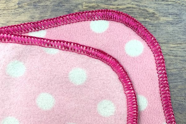 Use Dazzle™ in the upper loopers of your serger to finish any quilt or project with a simple but beautiful edge.
