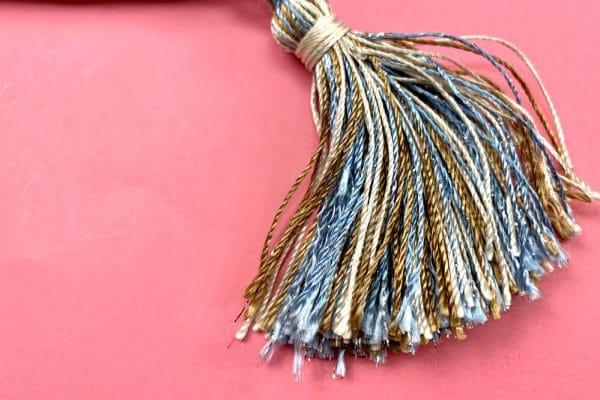Give your tassels a unique look with soft and shiny Dazzle™ thread.