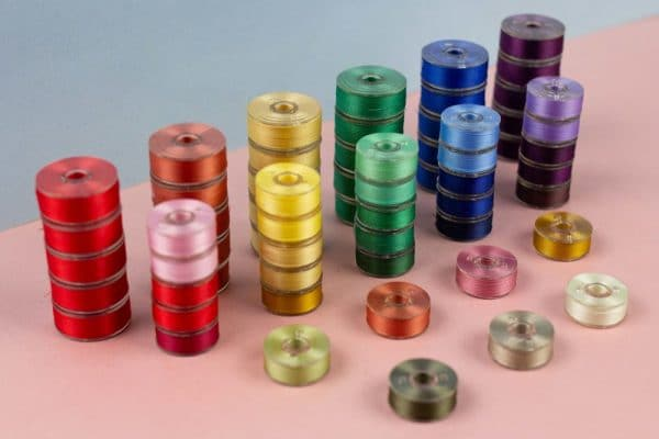 Available in reuseable pre-wound bobbins with no added adhesives for a cleaner sewing experience.