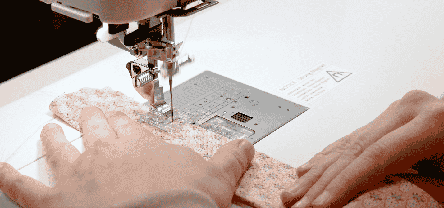 A close-up of hands holding a piece of paper Description automatically generated with low confidence