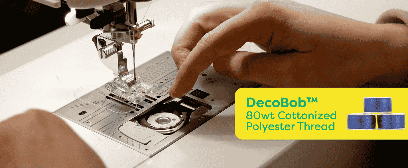 A picture containing person, sewing machine, indoor, appliance Description automatically generated